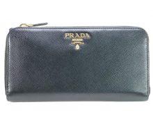 Prada Saffiano round zip wallet